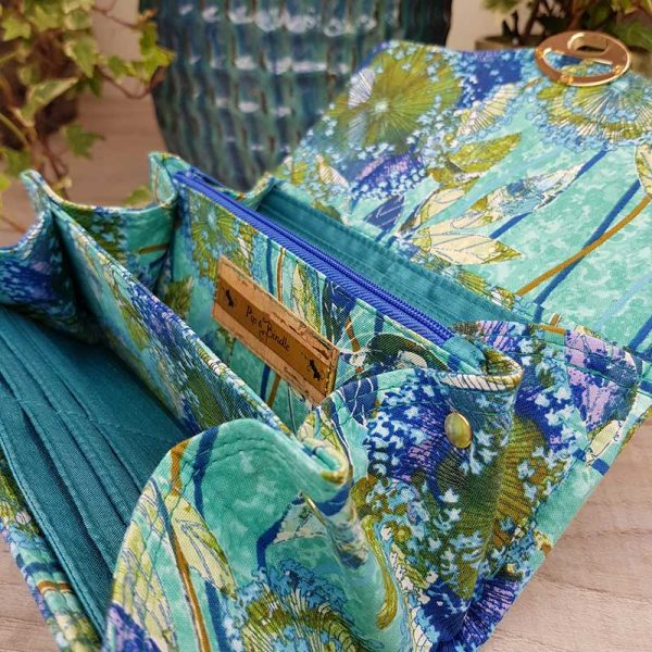 a stunning Clutch Wallet made in Turquoise green fabric with Gold hardware