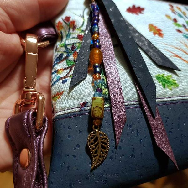 Luxury handmade accessory pouch in colourful Rainbow trees fabric and cork leather