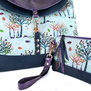 Both a large Hobo bag and an accessory pouch made in the stunning Rainbow trees fabric, cork and shing Purple faux leather